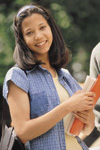Female student holding notebook