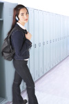 Girl leaning on lockers