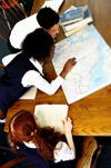 students reading a map