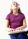 Girl reading Braille