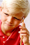 Boy with pencil thinking