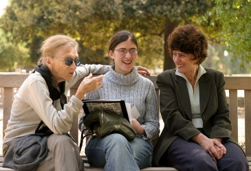 Three women talking on bench
