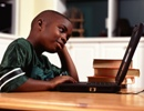 Boy doing homework on computer