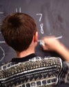 Boy completing math problem