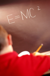 E=MC2 written on blackboard
