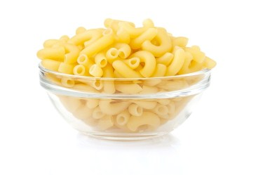 Bowl of elbow noodles against white background