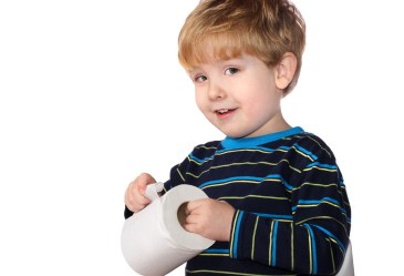 Young boy holding roll of toilet paper
