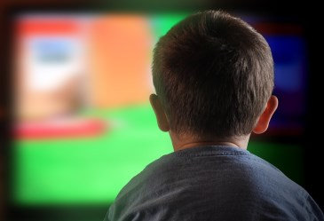 Outline of child sitting close to television