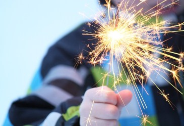 Close up of child holding sparkler in hand