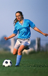 Girl teen playing soccer