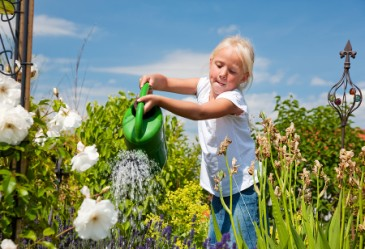 SpringActivities,Gardening,WateringFlowers,ChildWateringFlowers