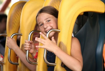 Close up of smiling girl on roller coaster