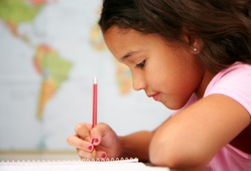 Closeup of young girl concentrating on school work.