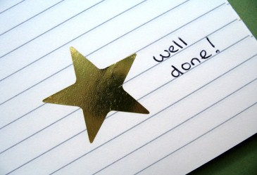Gold star sticker on index card