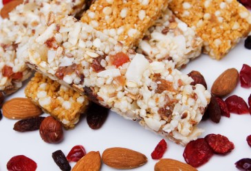Closeup of granola bars mixed with dried fruit, nuts, and coconut.