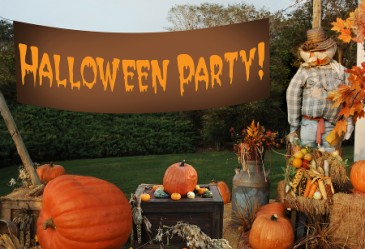 Halloween party complete with sign, hay bales, and scarecrows.