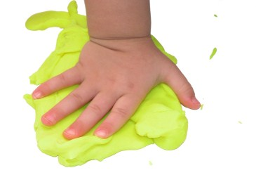 Child's hand in play dough