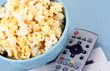 movie night bowl of popcorn and remote