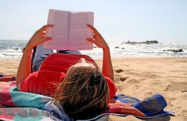 woman reading on the beach
