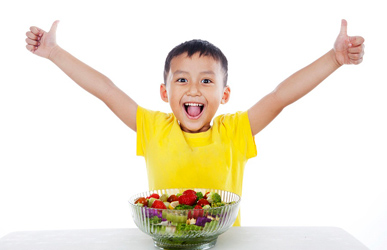 happy boy with healthy salad