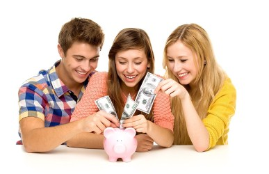 teens saving money in piggybank