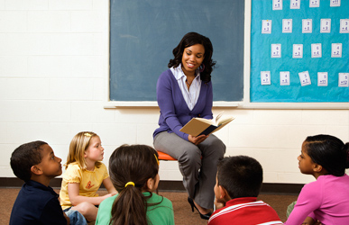 teacher reading to diverse classroom