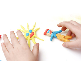 child playing with homemade playdough