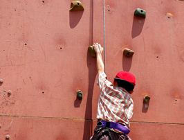 child on a rock-climbing wall