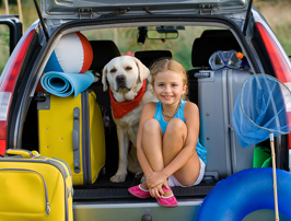 girl and dog ready for family travel