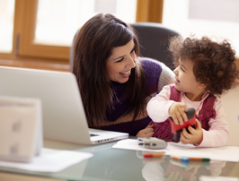 Mother and toddler at computer