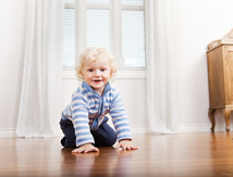 Toddler crawling on floor