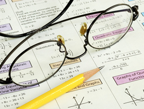 Glasses, pencil, and math worksheet