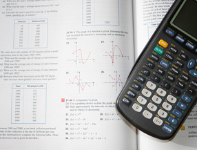 Algebra book and calculator