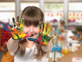 Happy girl with paint on hands