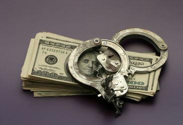 moneyandhandcuffs,corruptmoney