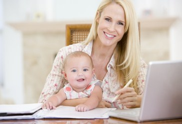 Mom sitting with baby at computer