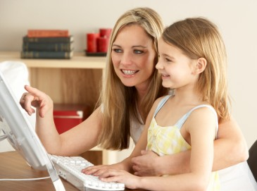 Tips for Learning Outside of School, Mom and girl search the internet together as learning activity