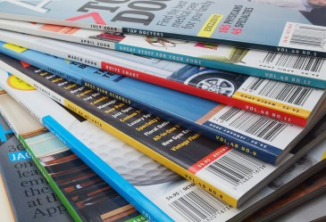 Pile of magazines against white back drop