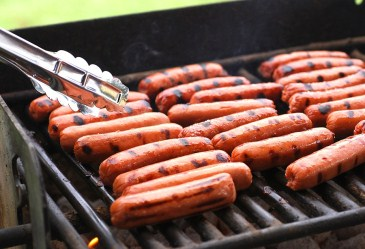 Rows of hot dogs on the grill