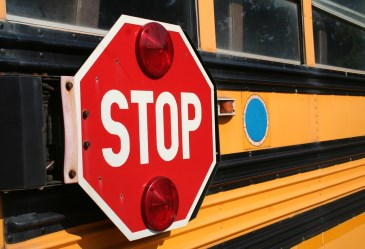 Close up of school bus stop sign