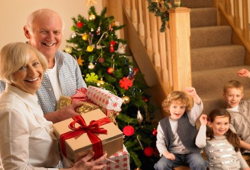 Grandparents arriving with Christmas presents for grandkids