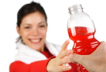 Woman reaching for sports drink