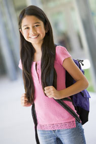 Younggirlstudentwithbookbag