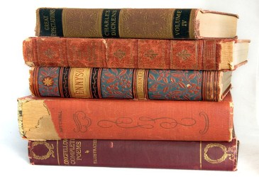 Pile of old books against white background