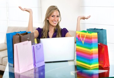 Woman standing among shoppingbags