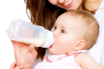 baby drinking bottle of formula
