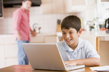 Summer Learning Tips for LD, boy on laptop