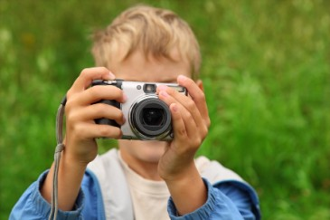 Summer camp essentials, boy with camera