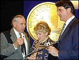 Image of Sen. Ben Campbel w/ Philip Diehl and Glenna Goodacre Holding New Sacagawea Dollar Coin