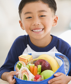 Boy Holding School Lunch